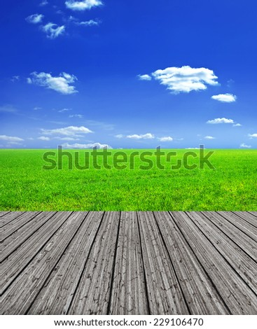 Rural landscape with wooden balcony floor in front  - stock photo