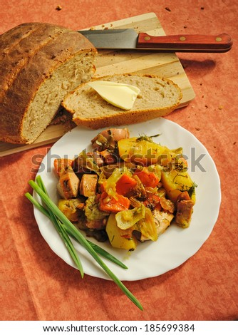 rural lunch with homemade bread - stock photo