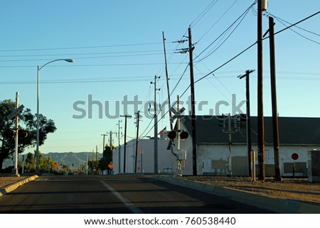 Rural Mountain Town Street View With Railroad Tracks