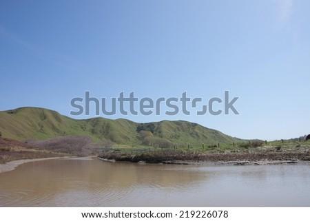 Rural New Zealand pastoral farming near a coastal river - stock photo