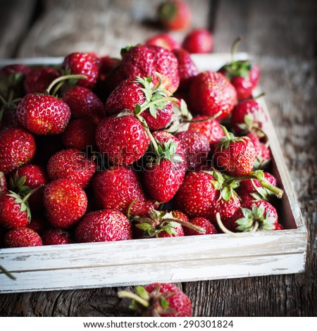 Rural Organic Strawberry is filled in a White Box on Wooden Table - stock photo
