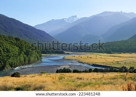rural picturesque landscape with river in New Zealand - stock photo