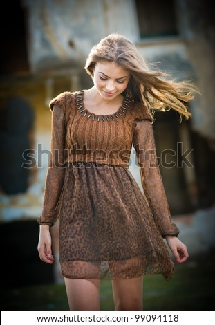 rural portrait of girl looking down - stock photo