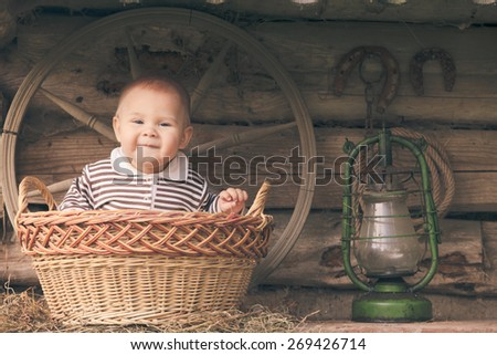 Rural retro still life. Table near the granary and adorable baby boy - stock photo