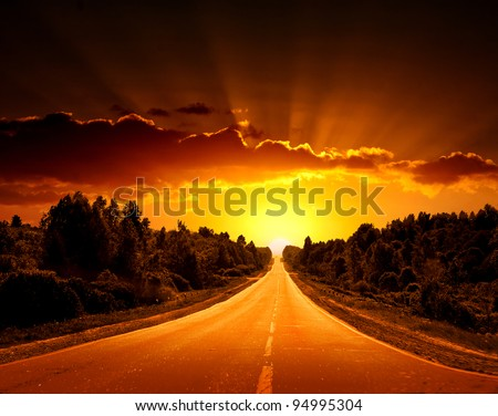 Rural road. A sunset. - stock photo