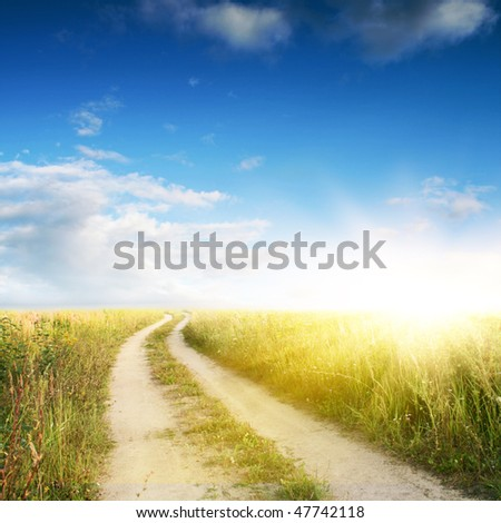 Rural road,blue sky and sun.