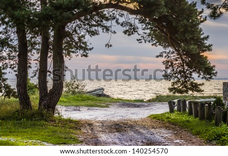 Rural road leading to the beach of Baltic Sea. Latvia, Europe - stock photo