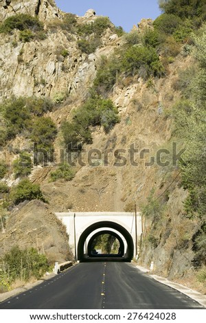 Rural road leads to a tunnel through a mountain on highway 33 in Ojai, Ventura County California