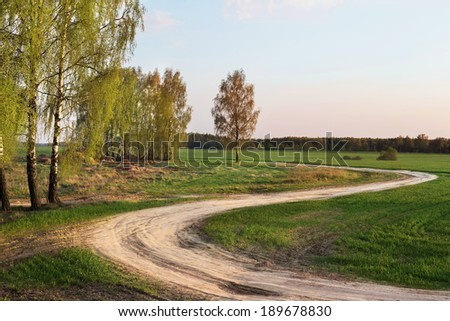 Rural road on sunset - stock photo