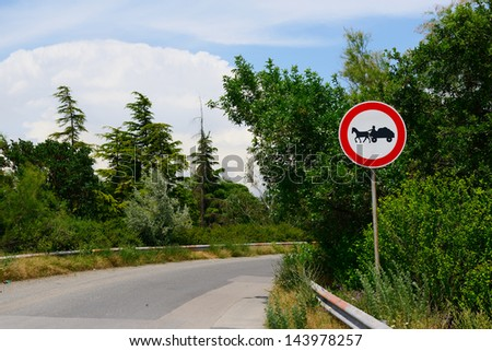 rural road sign, horse with cart