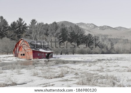 Rural Scene with Old Barn and field in the mountains with color filter - stock photo