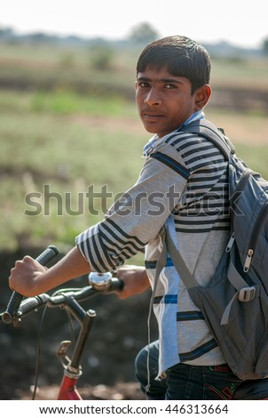 Rural school boy going to school on bicycle at Salunkwadi, Ambajogai, Beed, Maharashtra, India, Southeast Asia.