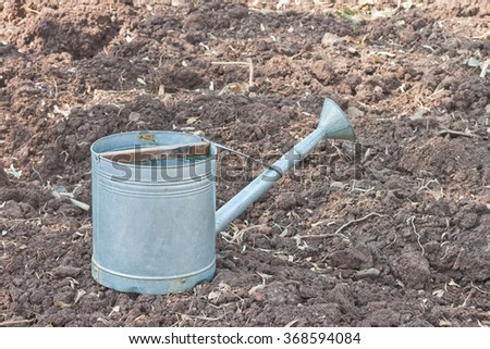 Rural style metal watering pot - stock photo