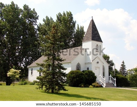 rural white church among trees