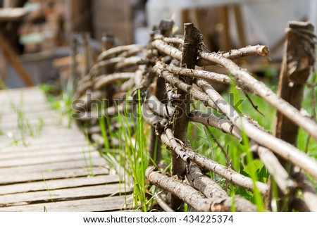 Rural wooden fence. Natural summer background. Selective focus - stock photo