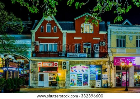 RUSE, BULGARIA, MARCH 25, 2015: night view of illuminated street in city center of the 5th biggest bulgaria town ruse - rousse.