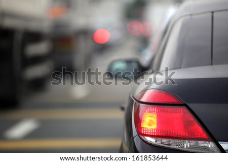 Rush hour traffic congestion focus on tail brake light - stock photo