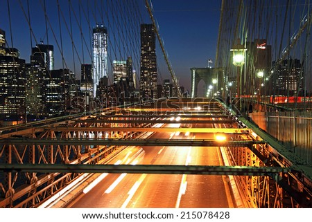 Rush hour traffic on the Brooklyn Bridge at night in New York - stock photo
