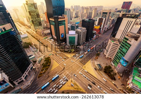 Rush hour traffic zips through an intersection in the Gangnam district of Seoul, South Korea. - stock photo