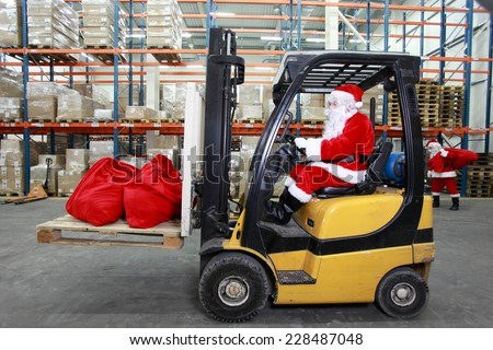 Rush hours before Christmas.Santa Claus as a forklift operator at work in warehouse - stock photo