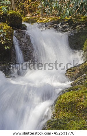 Rushing Cascade of the Huskey Branch Falls in the Great Smoky Mountains of Tennessee - stock photo