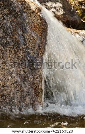 Rushing water pours over rock in Swift River in New Hampshire