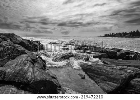 Rushing wave on Maine's rocky coastline taken in Bristol near Pemaquid lighthouse. - stock photo