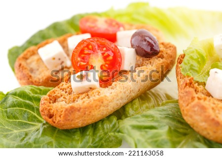 Rusks, feta cheese and vegetables on white background. - stock photo
