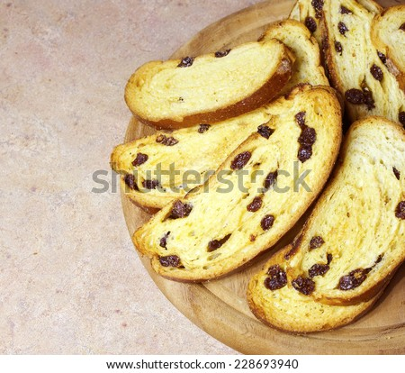 Rusks with raisins on a cutting board - stock photo