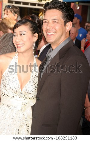 "Russell Wong and wife Flora  at the Premiere of ""The Mummy Tomb of the Dragon Emperor"". Gibson Amphitheatre, Universal City, CA. 07-27-08"