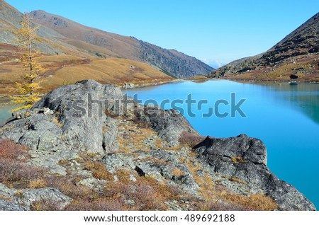 Russia, Altai mountains, lake Acchan (Akchan) in autumn in sunny weather