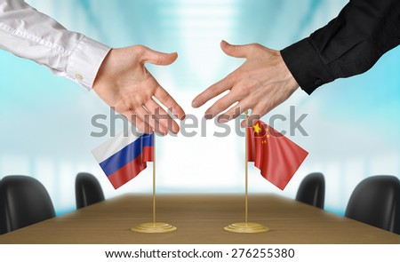 Russia and China diplomats agreeing on a deal - stock photo