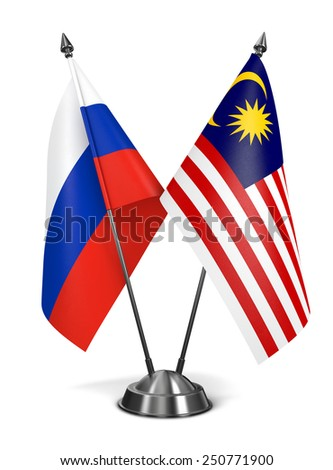 Russia and Malaysia - Miniature Flags Isolated on White Background.
