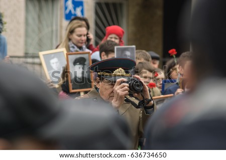 Russia. Balashikha. Celebration of the Victory Day in World War II. War veterans gathered in the square. People and children congratulate. May 9, 2017 year.