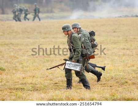 RUSSIA, BORODINO - OCTOBER 12: Unidentified armed german soldiers attack on the field on reenactment of the battle in WWII near the Borodino village in 1941, in Moscow region, on 12 October, 2014