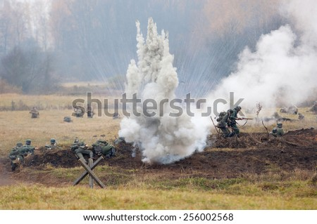 RUSSIA, BORODINO - OCTOBER 12: Unidentified armed german soldiers sit down on the field on reenactment of the battle in WWII near the Borodino village in 1941, in on 12 October, 2014, Russia