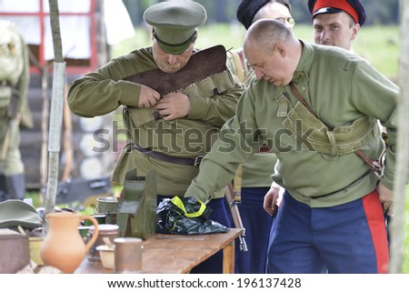 RUSSIA, CHERNOGOLOVKA - MAY 17: Unidentified men reloads in military uniform on History reenactment of battle of Civil War in 1914-1919 on May 17, 2014, Chernogolovka city, Ivanovskoe village, Russia