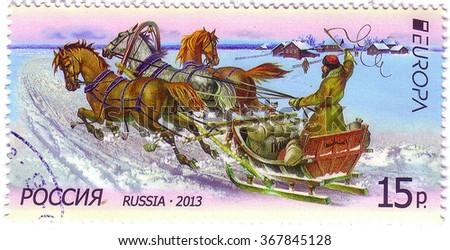 RUSSIA - CIRCA 2013: A postal stamp printed in Russia shows winter sledge race, circa 2013 - stock photo