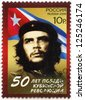 RUSSIA - CIRCA 2009: A stamp printed in Russia shows commander Ernesto Guevara de la Serna (Che Guevara) and Republic of Cuba national flag, 50th anniversary of Cuban revolution Victory, circa 2009 - stock photo