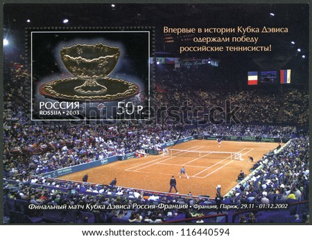 RUSSIA - CIRCA 2003: A Stamp printed in Russia shows The Russian Tennis Players - Winners of the Davis Cup 2002, circa 2003 - stock photo