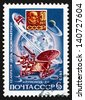 RUSSIA - CIRCA 1973: a stamp printed in the Russia shows Lunokhod 2 on Moon and Lenin Moon Plaque, Cosmonauts Day, circa 1973 - stock photo