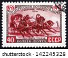 RUSSIA - CIRCA 1958: a stamp printed in the Russia shows Troika, 19th Century, Traditional Russian Harness Driving Combination, Centenary of Russian Postage Stamps, circa 1958 - stock photo