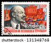 RUSSIA - CIRCA 1960: A stamp printed in USSR, shows portrait of the Lenin and demonstration, series  90th anniversary of Lenin's birth, circa 1960 - stock photo