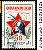 RUSSIA - CIRCA 1974: A stamp printed in USSR, shows Red Star Newspaper, Soldier.  50th anniversary Red Star Newspaper , circa 1974 - stock photo