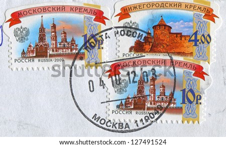 RUSSIA - CIRCA 2009: A trio of stamps printed in Russia shows image of the Moscow Kremlin and Nizhny Novgorod Kremlin, circa 2009.