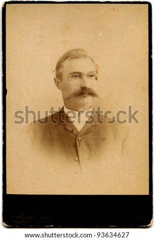 RUSSIA - CIRCA 1889: An antique photo shows man with a mustache, Kursk, the Russian Empire, 1889 Russian text: Nuzhdenko (photographer), Kursk