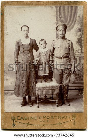RUSSIA - CIRCA 1916: An antique photo shows soldier with his woman and girl, the Russian Empire, 1916 - stock photo