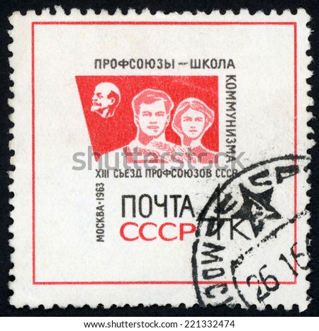 RUSSIA - CIRCA 1963: post stamp printed in USSR (CCCP, soviet union) shows head of Lenin and young workers; 13th congress of soviet trade union Moscow; Scott 2800 A1417 4k red black; circa 1963 - stock photo