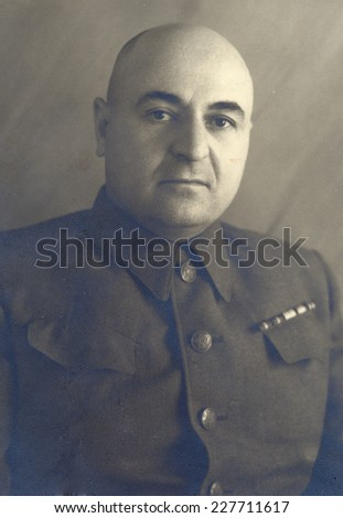 Russia, - CIRCA 1949s: An antique studio portrait of middle-aged man in a military uniform with ribbons.