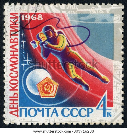 RUSSIA - CIRCA 1968: stamp printed by Russia, shows astronaut, planet, space, circa 1968 - stock photo
